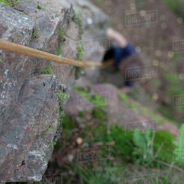 Girl rock climbing with focus on rope Royalty-free stock photo