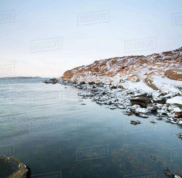 Snow covered rocks by sea, West Coast, Bohuslan, Sweden Royalty-free stock photo