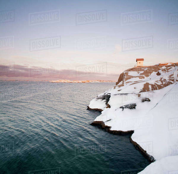 Snow covered rock surface by water, Lysekil, Sweden Royalty-free stock photo