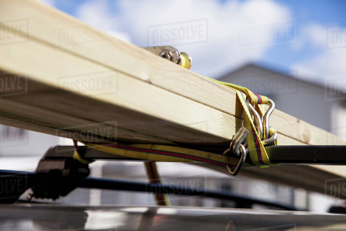 Close Up Of Wooden Plank Tied On Roofrack Of Car Stock Photo