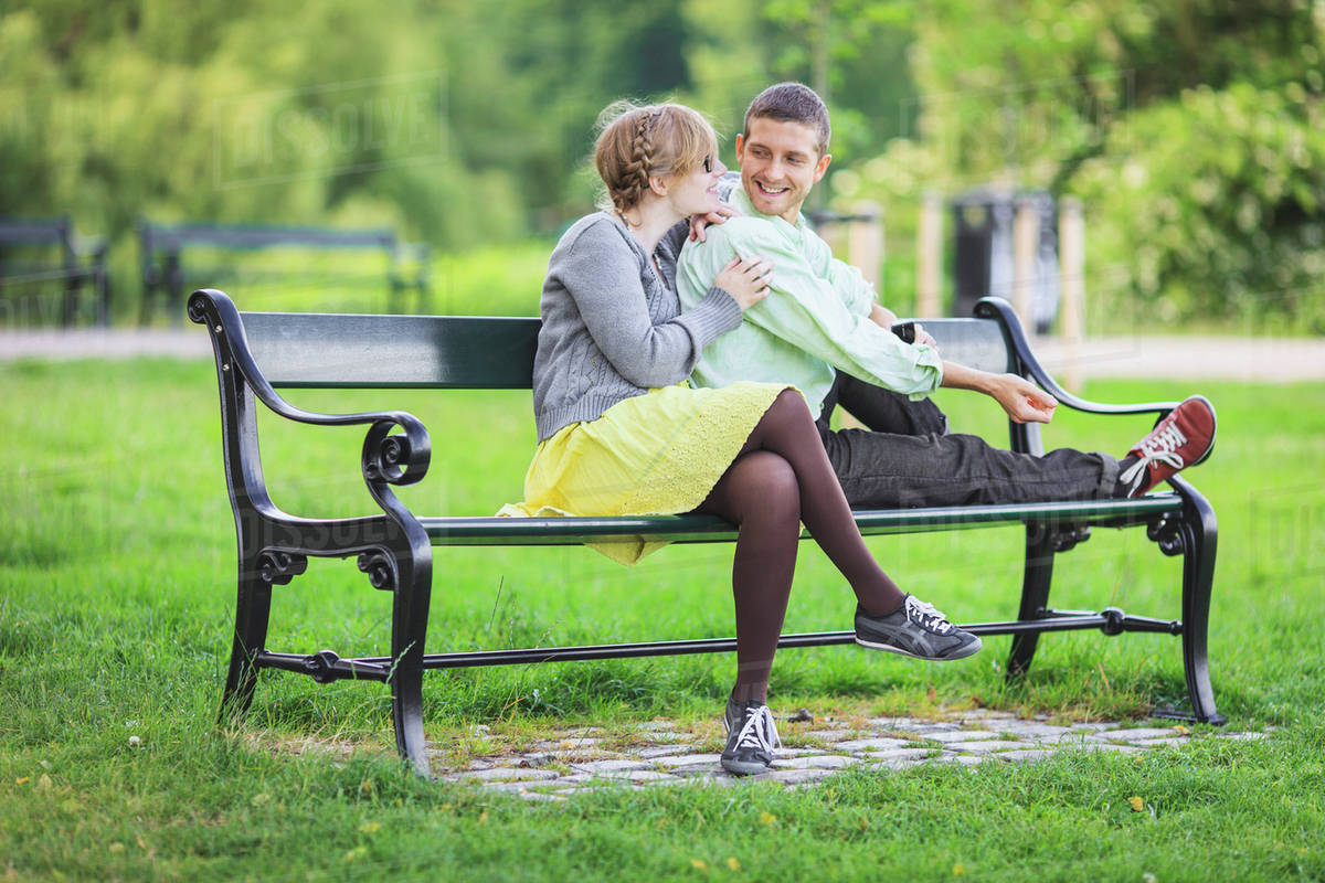 Loving Couple Sitting On Park Bench Stock Photo Dissolve
