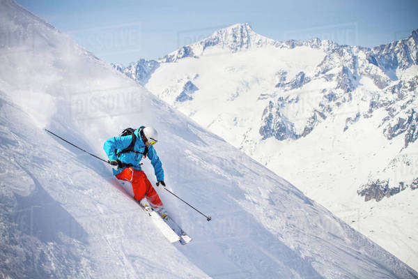 Full length of man skiing on mountain slope Royalty-free stock photo
