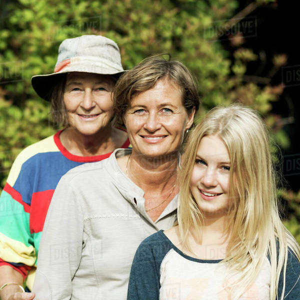 Portrait of happy three generation females at yard Royalty-free stock photo