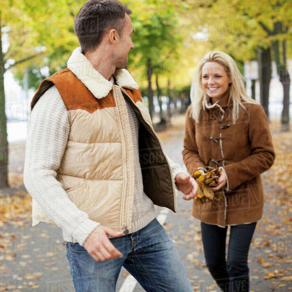 Playful young couple on street during autumn Royalty-free stock photo
