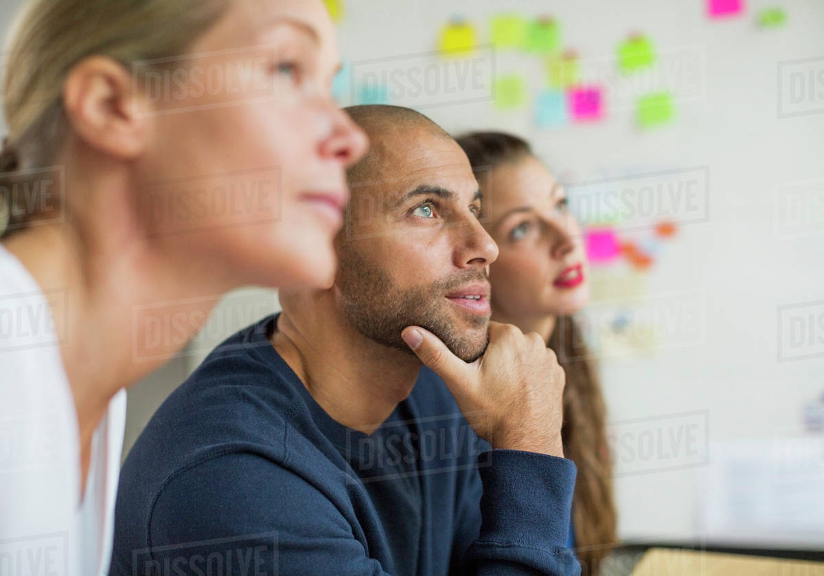 Business people looking away in creative office Royalty-free stock photo