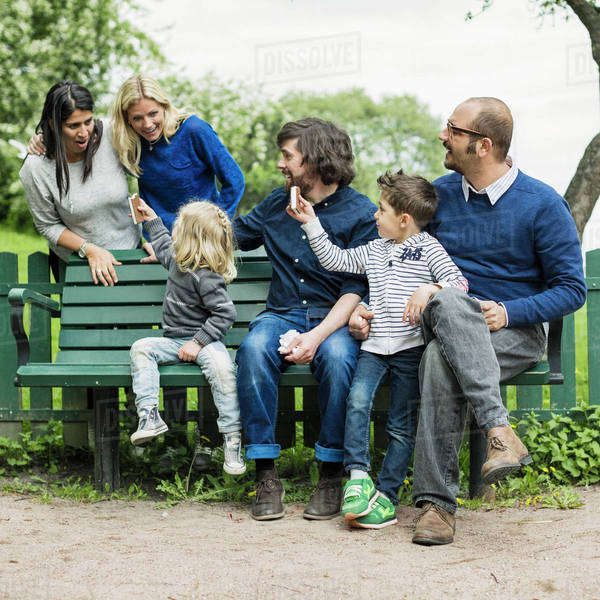 Homosexual families spending leisure time in park Royalty-free stock photo