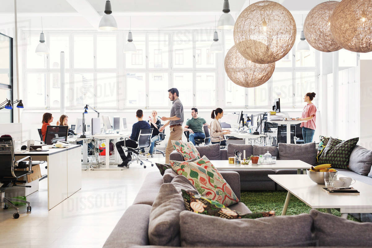 Great Modern Office Lobby With Business People Working In Background