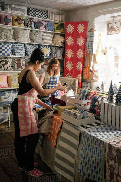 Female owners working on textile in shop Royalty-free stock photo