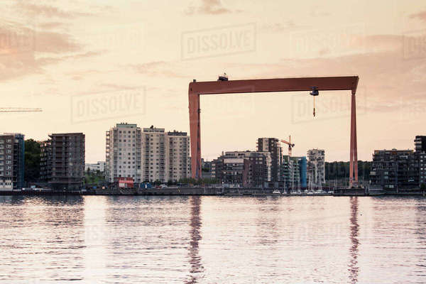Buildings by river at Eriksberg against sky during sunset Royalty-free stock photo