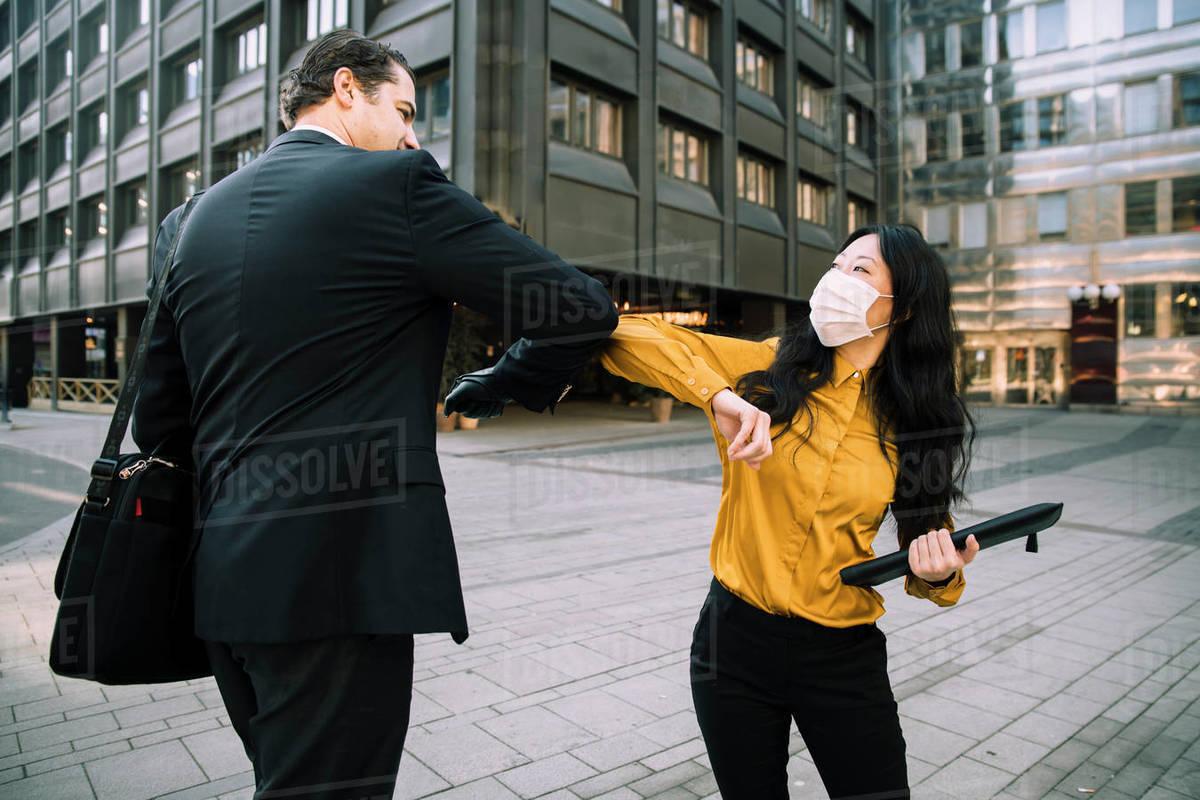 Business people greeting during virus pandemic Royalty-free stock photo