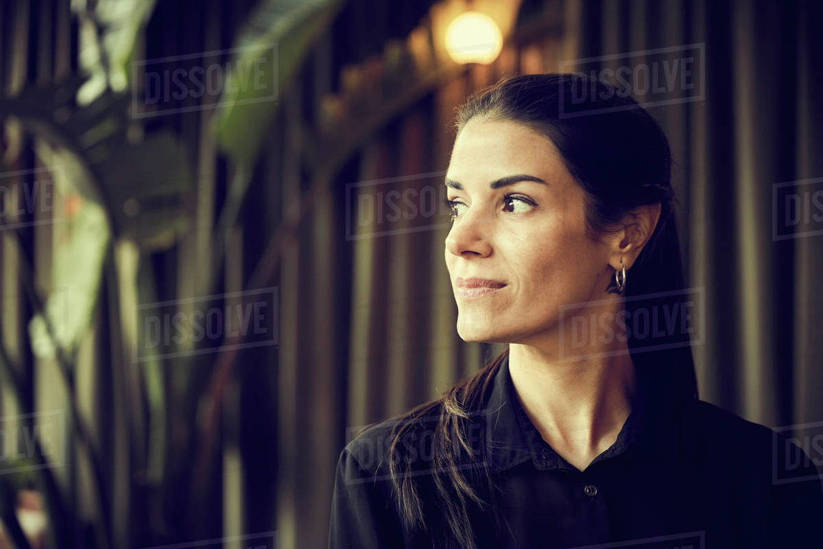 Confident female owner looking away while standing in cafe Royalty-free stock photo