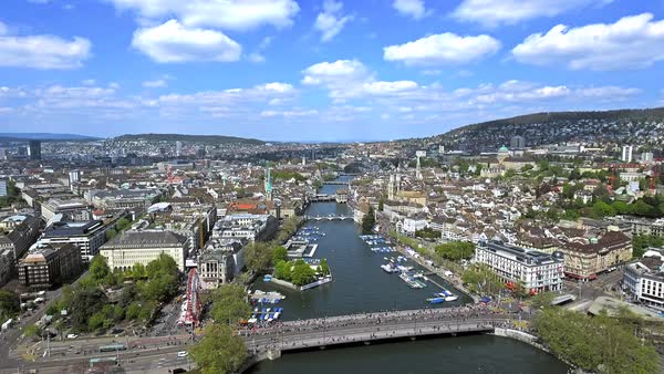 Aerial View of Zurich Cityscape in Switzerland with Beautiful Sky and Clouds featuring City Center Town Hall and Famous Landmarks Royalty-free stock video