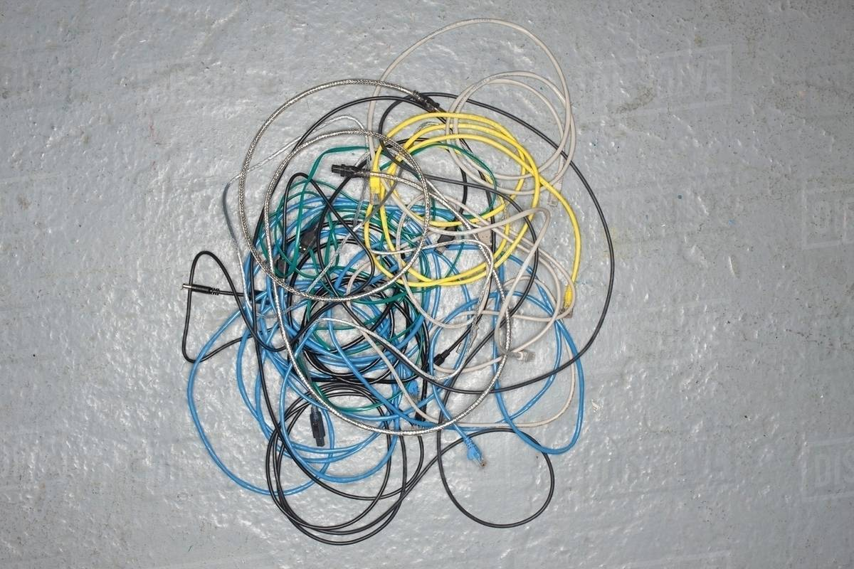 A tangle of colored wires on the ground - Stock Photo - Dissolve