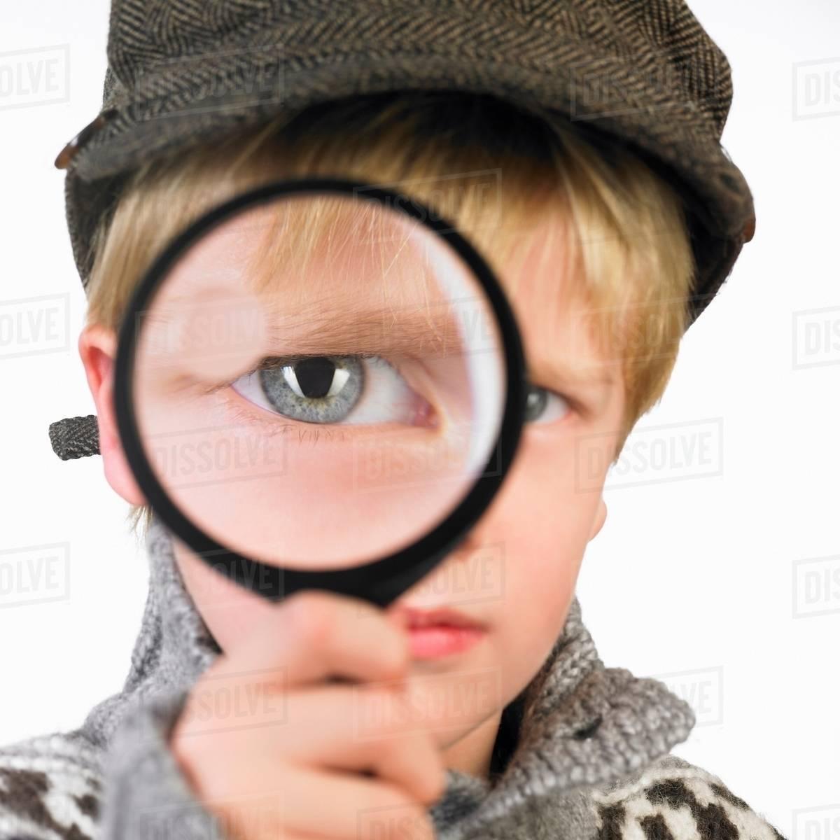 Boy's eye through a magnifying glass Royalty-free stock photo
