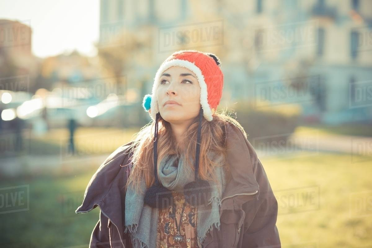 Mid adult woman wearing red pom pom hat in park - Stock Photo - Dissolve cff50c3a36f