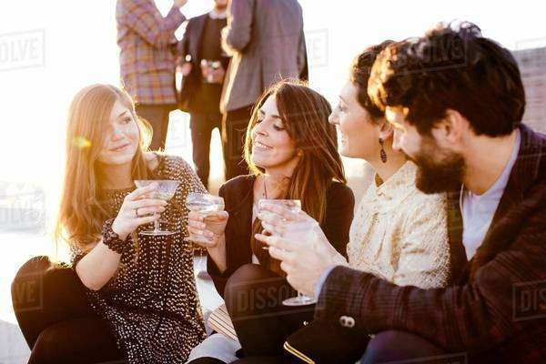 Group of friends laughing and drinking at party Royalty-free stock photo