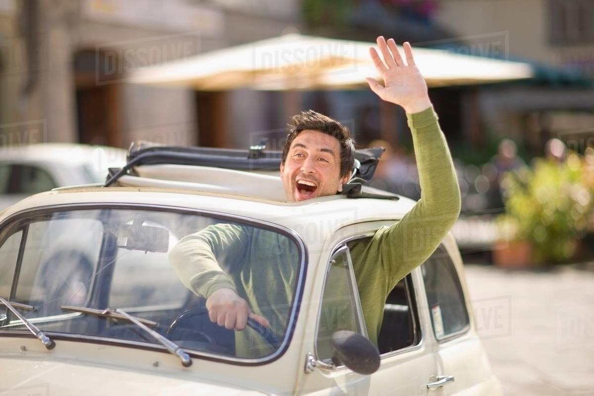 man in car waving with arm out of window stock photo dissolve. Black Bedroom Furniture Sets. Home Design Ideas