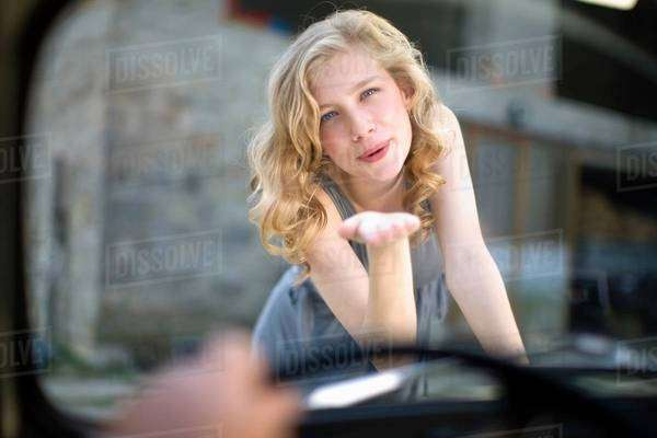 Girl kissing man in in car Royalty-free stock photo