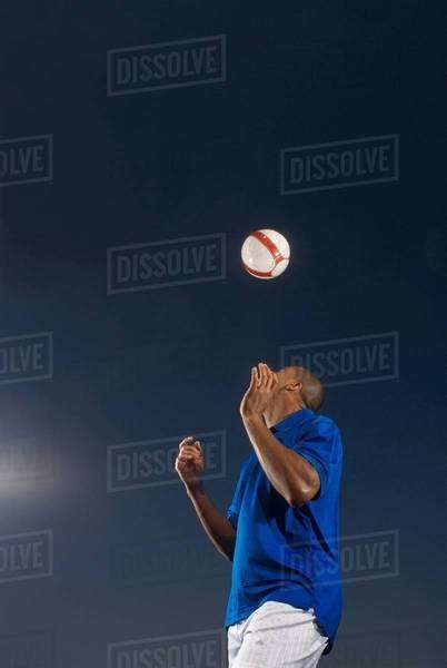 Man bouncing soccer ball on his head Royalty-free stock photo