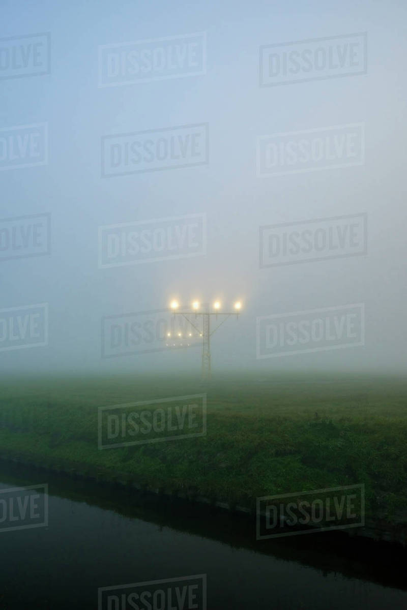 Aircraft landing lights at Schiphol airport, in heavy fog, Amsterdam,  Noord-Holland, Netherlands stock photo