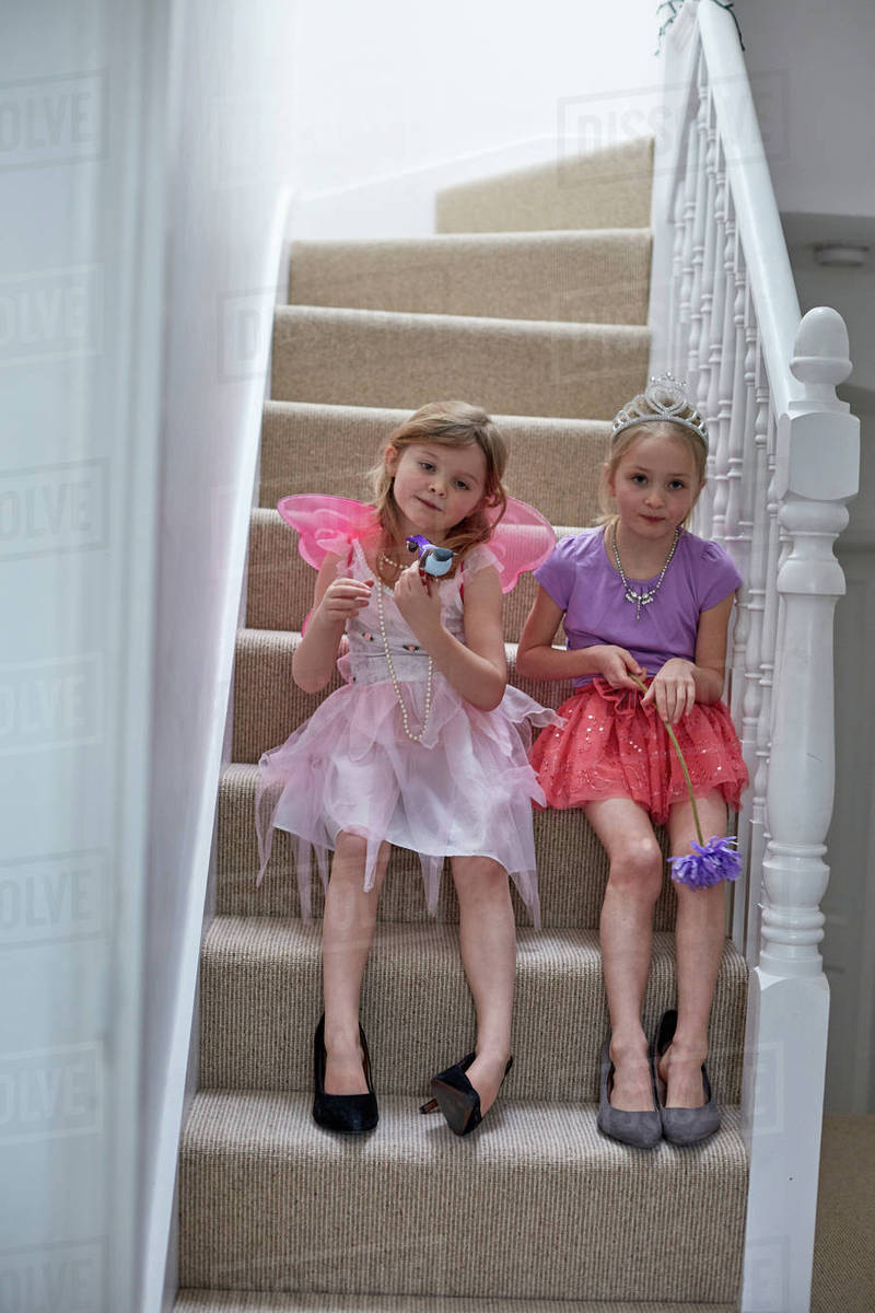 Girls in costume waiting on staircase Royalty-free stock photo
