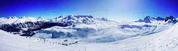 Panoramic view of ski lift in snow covered mountains, Sankt Moritz, Engadin, Switzerland Royalty-free stock photo