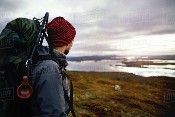 Hiker enjoying view of lake, Keimiotunturi, Lapland, Finland Royalty-free stock photo