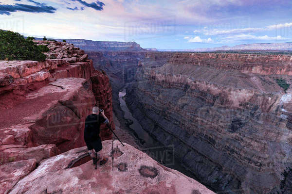 Photographer photographing view from Torroweap overlook, Littlefield, Arizona, USA Royalty-free stock photo