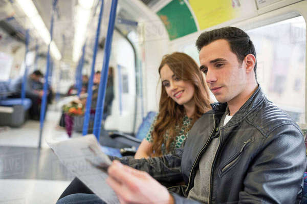 Couple on train reading newspaper Royalty-free stock photo