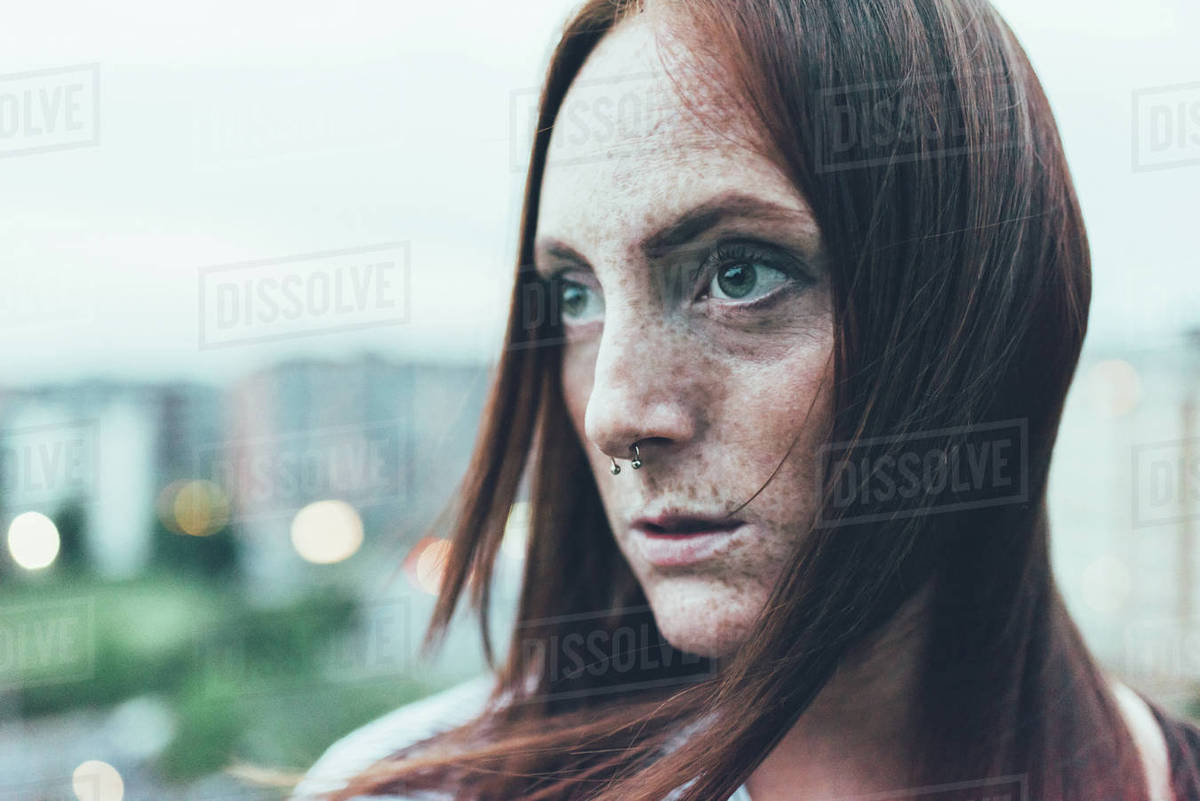 Close Up Portrait Of Young Freckled Woman With Long Red Hair And Nose Piercing Stock Photo