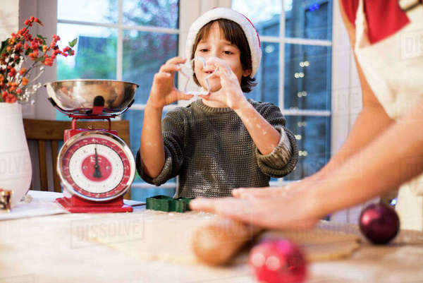Mother and son making Christmas cookies at home Royalty-free stock photo