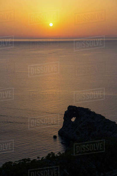 Golden sunset over sea horizon, Sa Foradada, Majorca, Spain Royalty-free stock photo