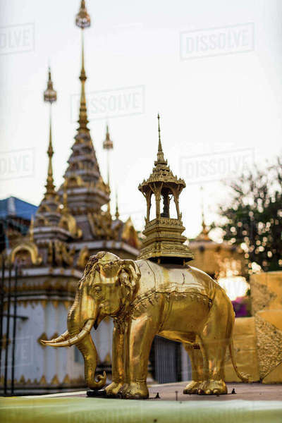 Golden elephant statue and spires of buddhist temple, Chiang Mai, Thailand Royalty-free stock photo