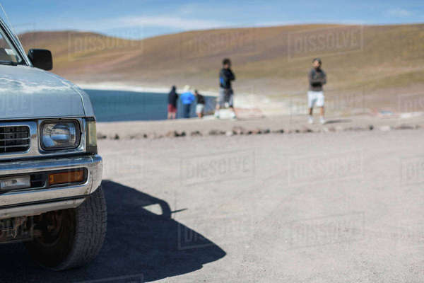 Vehicle and people by lake miscanti, San Pedro de Atacama, Chile Royalty-free stock photo