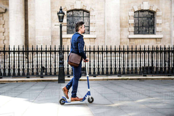 Businessman on scooter, London, UK Royalty-free stock photo