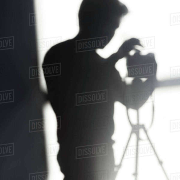 Shadow of photographer with camera on tripod Royalty-free stock photo
