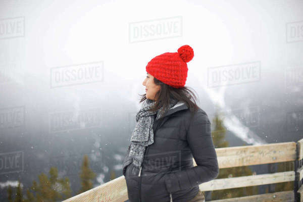 Woman looking away at view of misty forest, Banff, Canada Royalty-free stock photo