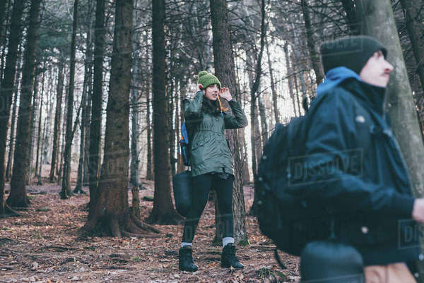 Hiking couple in forest, Monte San Primo, Italy Royalty-free stock photo