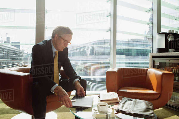 Businessman in coffee area in office, London, UK Royalty-free stock photo