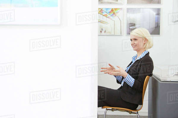 Female designer sitting in office explaining Royalty-free stock photo