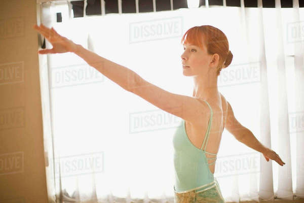 Ballet dancer posing in front of window Royalty-free stock photo