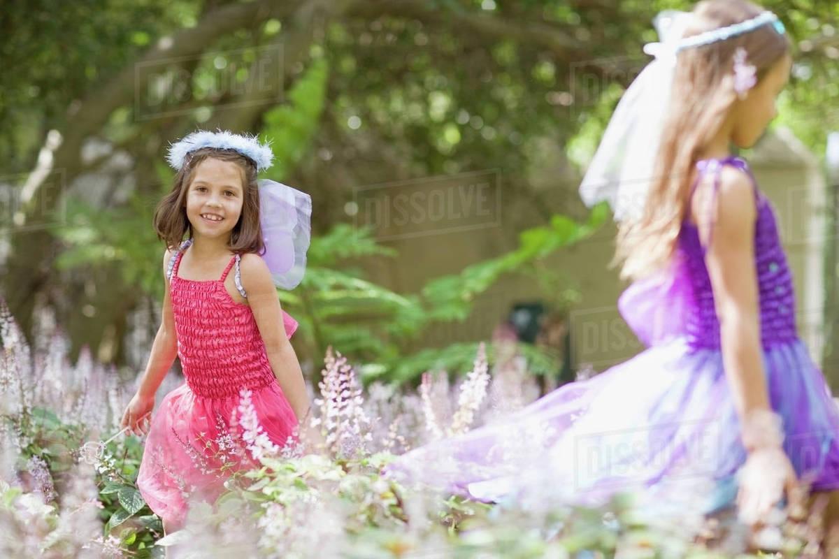 Girls wearing fairy costumes in backyard Royalty-free stock photo