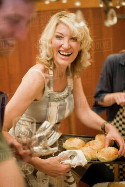 Woman laughing while serving bread Royalty-free stock photo