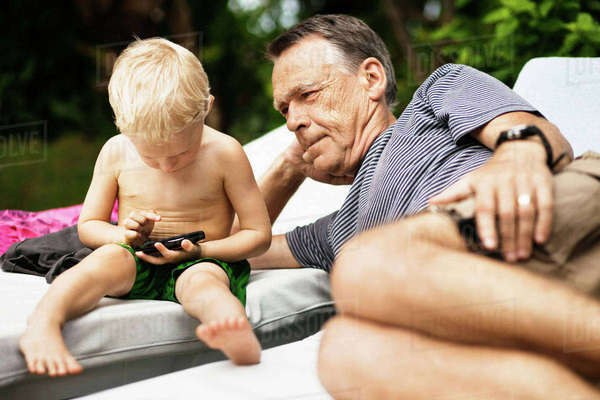 Older man relaxing with grandson Royalty-free stock photo
