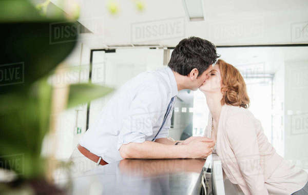 Man kissing receptionist Royalty-free stock photo