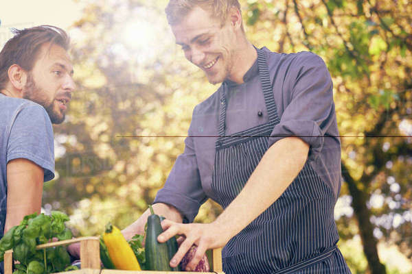 Chef receiving delivery of crate of vegetables Royalty-free stock photo