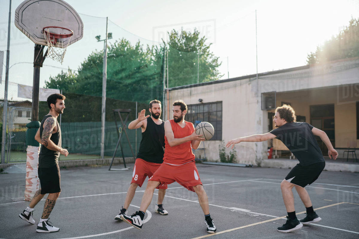 Friends On Basketball Court Playing Basketball Game Stock Photo Dissolve