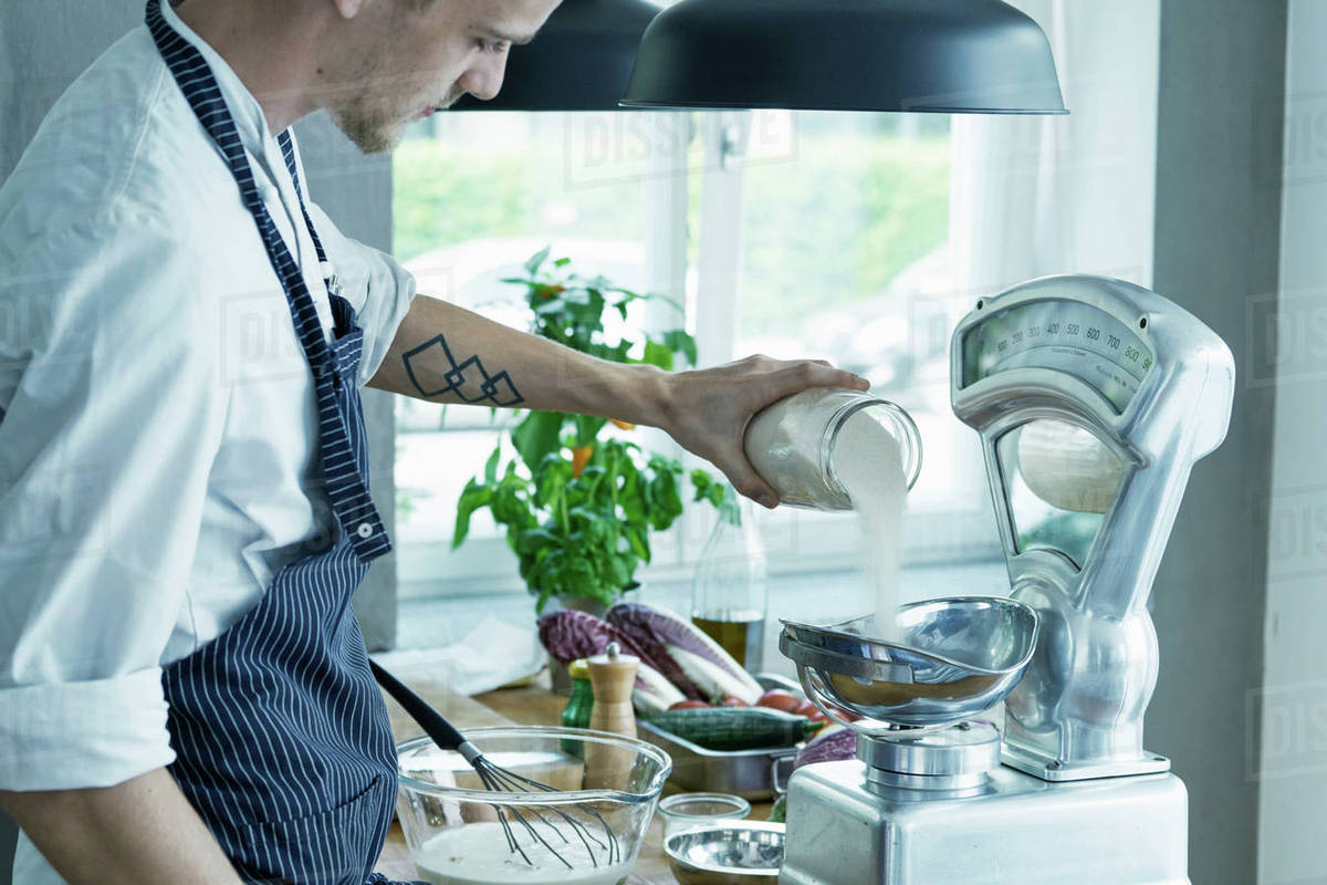 Male chef, weighing ingredients on vintage scales - Stock Photo ...