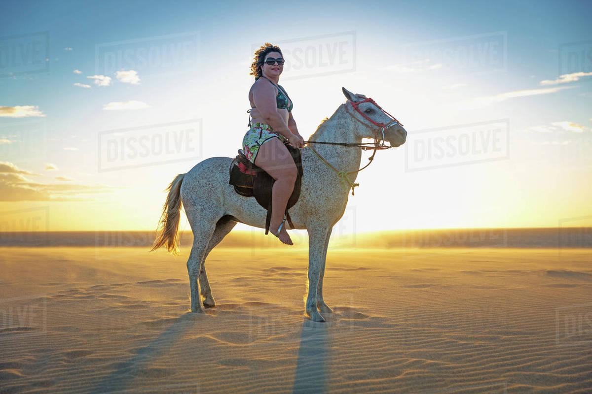 Woman Riding Horse On Beach Side View Jericoacoara Ceara Brazil South America Stock Photo Dissolve