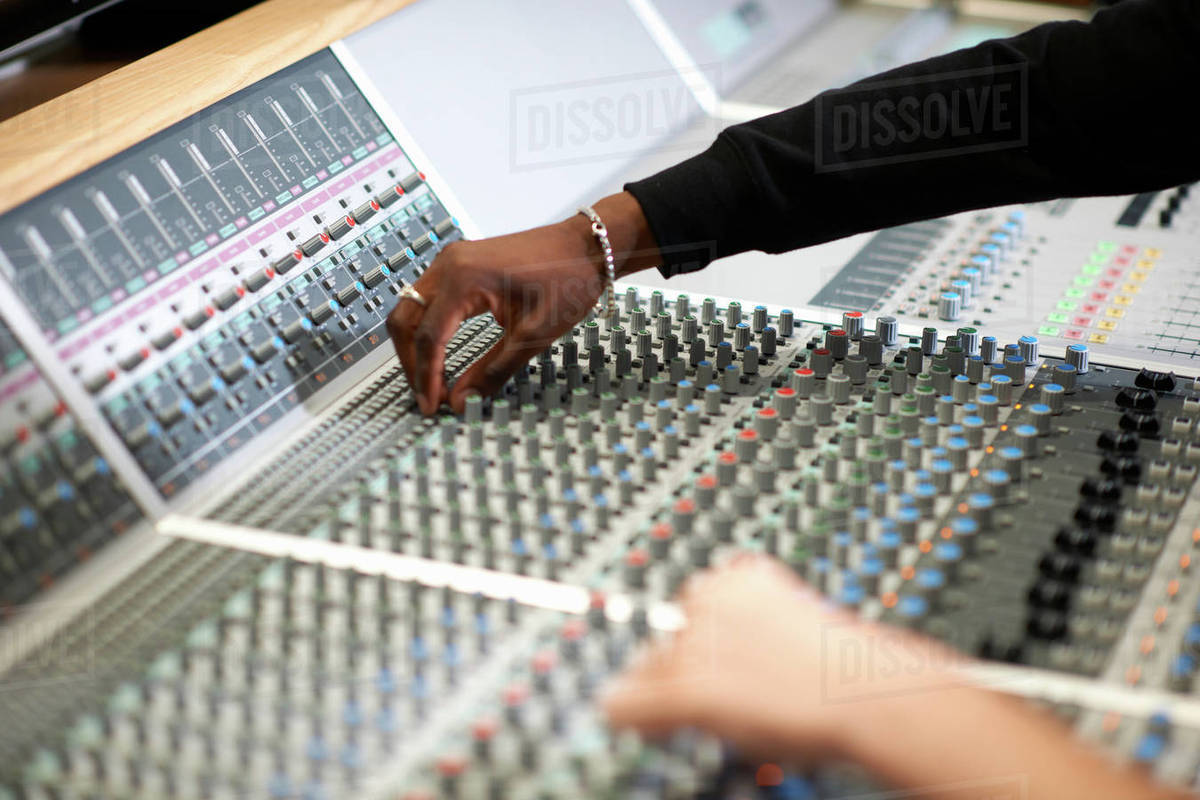 Hands of male college students at sound mixer in recording studio stock  photo